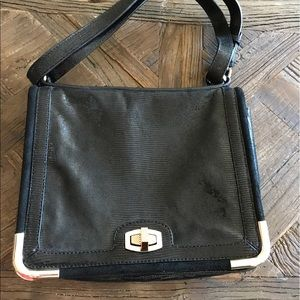 Ann Taylor leather purse with blue lining.